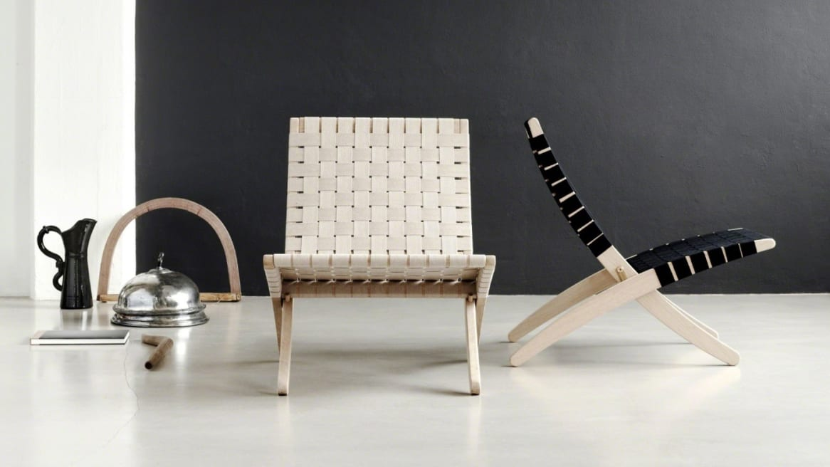 A Cuba chair with a white seat and a Cuba chair with a black seat are seen next to each other