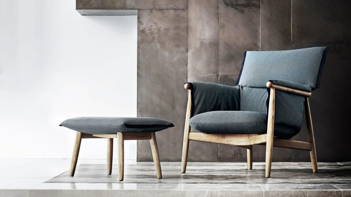 An Embrace Lounge Chair CHE015 by Carl Hansen & Son paired with an ottoman