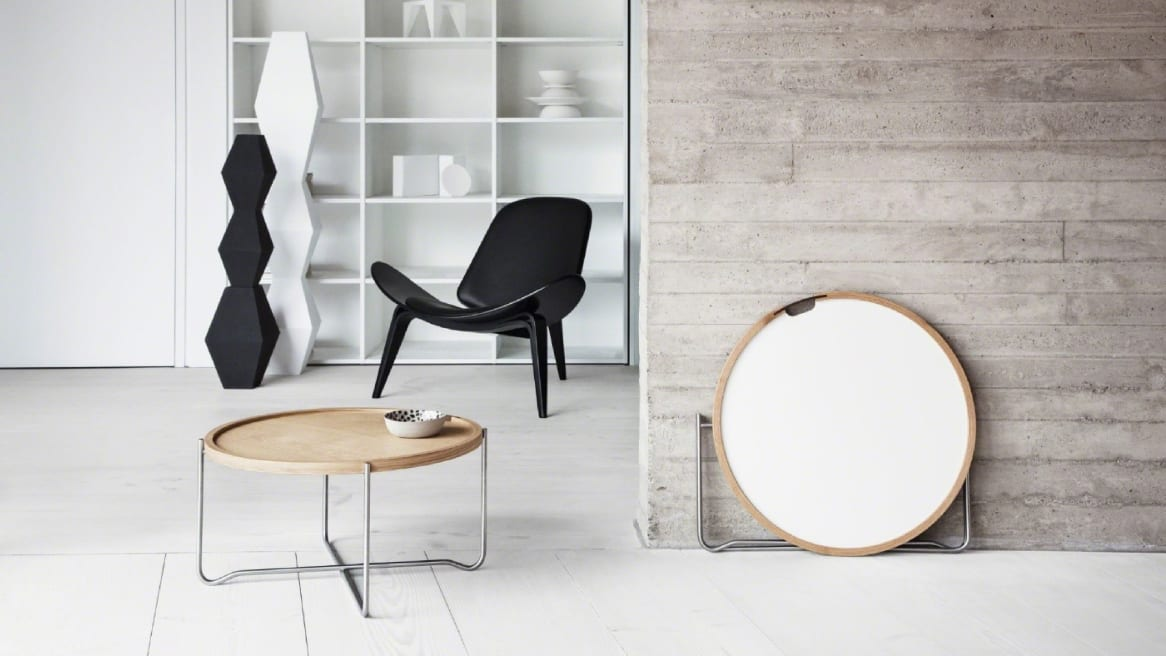 A Carl Hansen & Son CH417 Tray Table with light wood top is in the foreground with a black Shell chair in the background