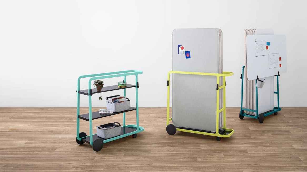 Yellow and teal Steelcase Flex board carts are shown carrying boards while a mint green Steelcase Flex team cart is shown nearby