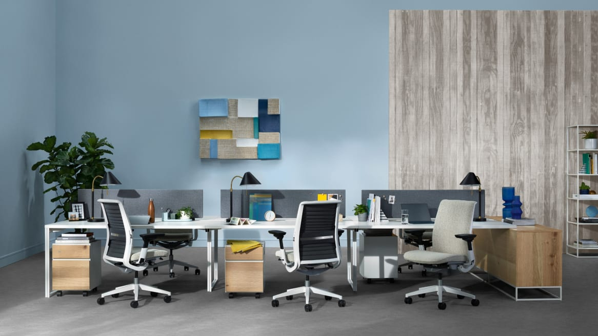 office desk system for six with beige upholstered office chairs and personal storage cabinets