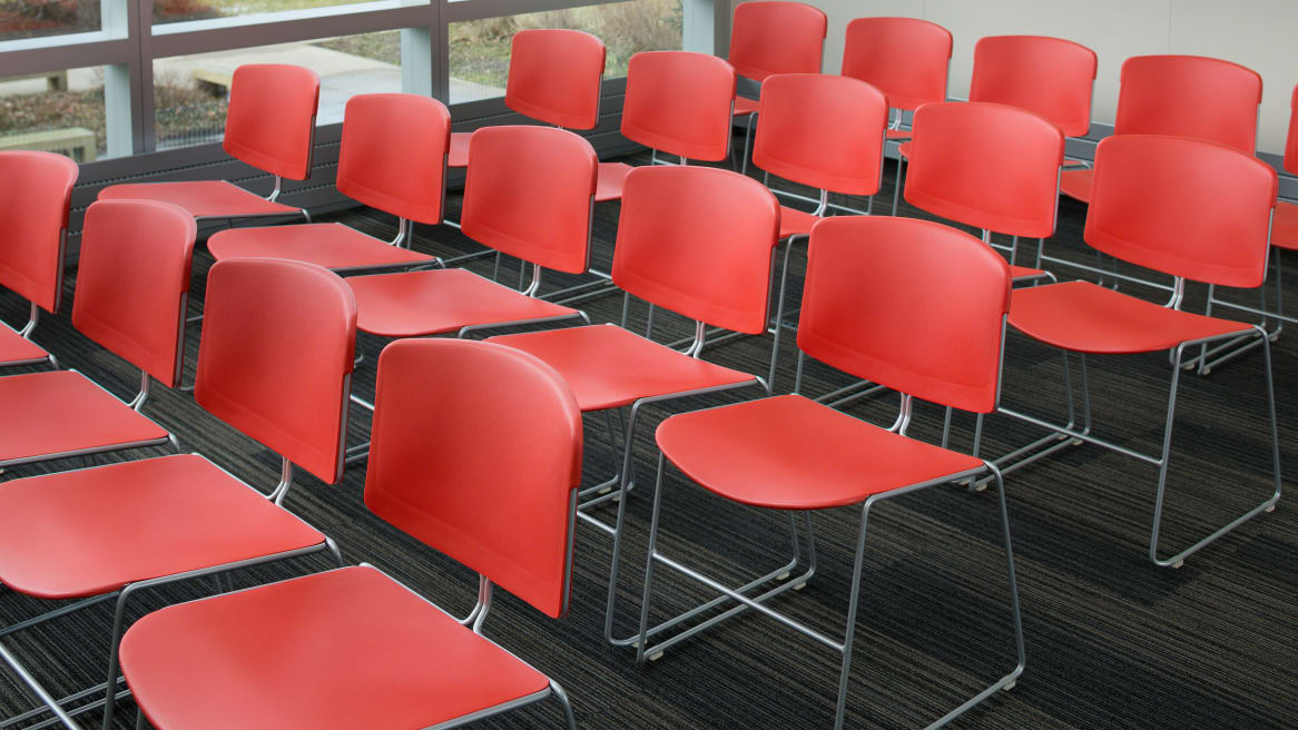 conference room set up with red Max Stacker III chairs