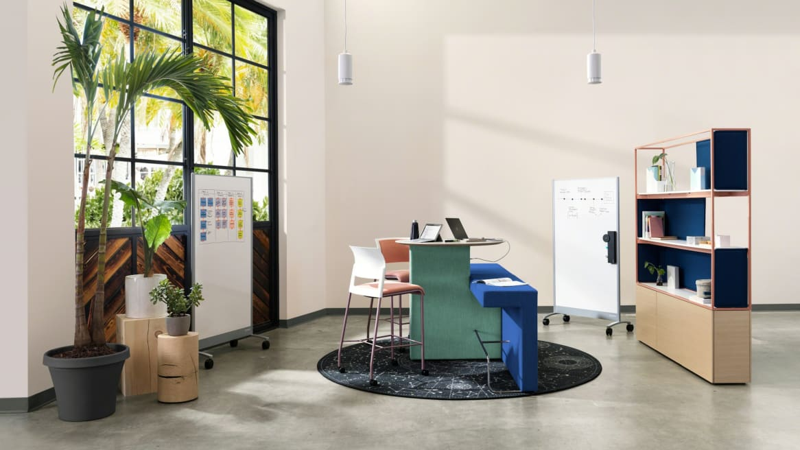 Open Collaboration space with green and blue Orangebox Border bench, pink Move stools, Celestial rug