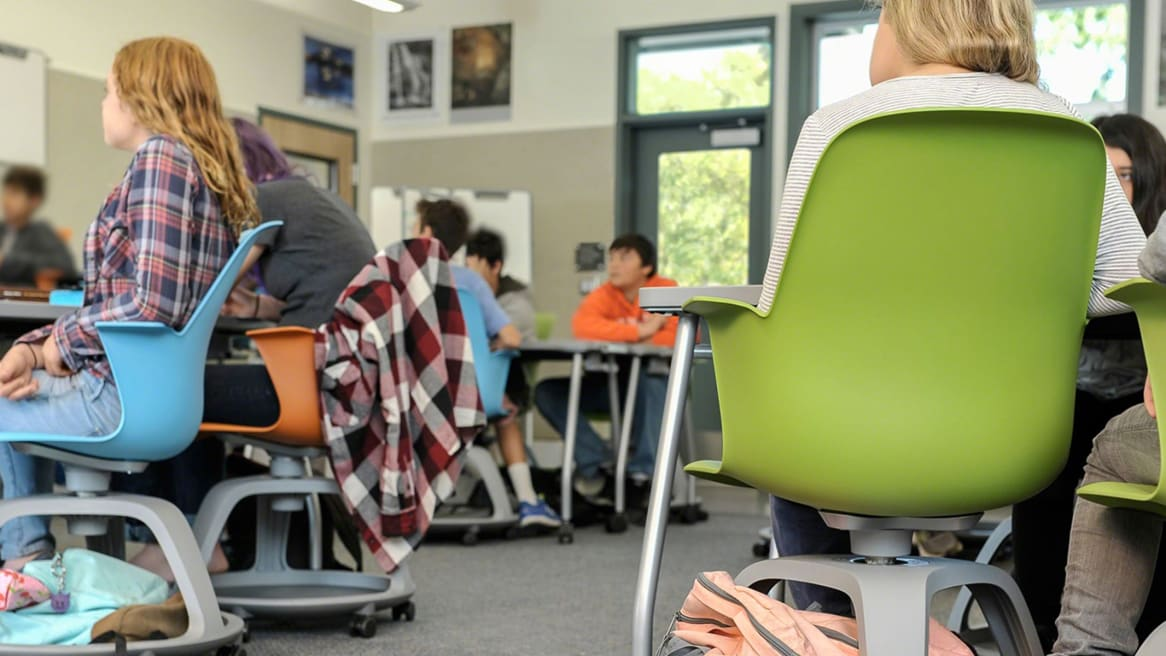 Students inside a classroom seated on Node chairs