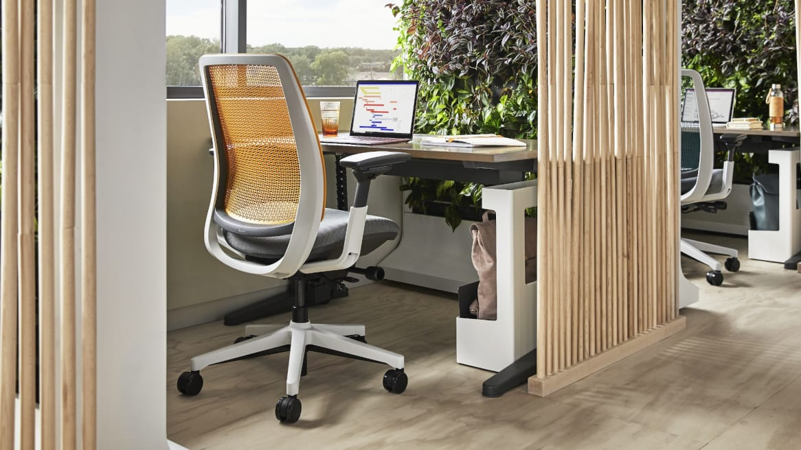 Private space with a height adjustable desk and Amia chair