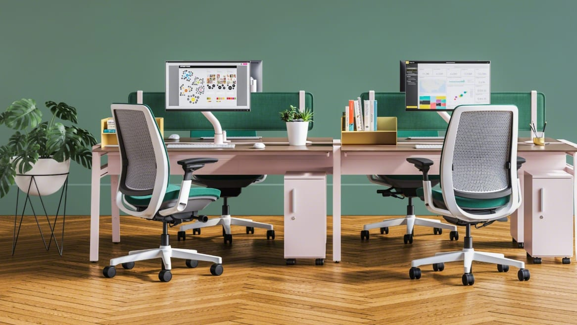 collaborative space with wooden desk and blue amia chairs