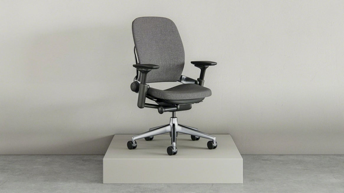 Full view of a gray Leap chair on a platform