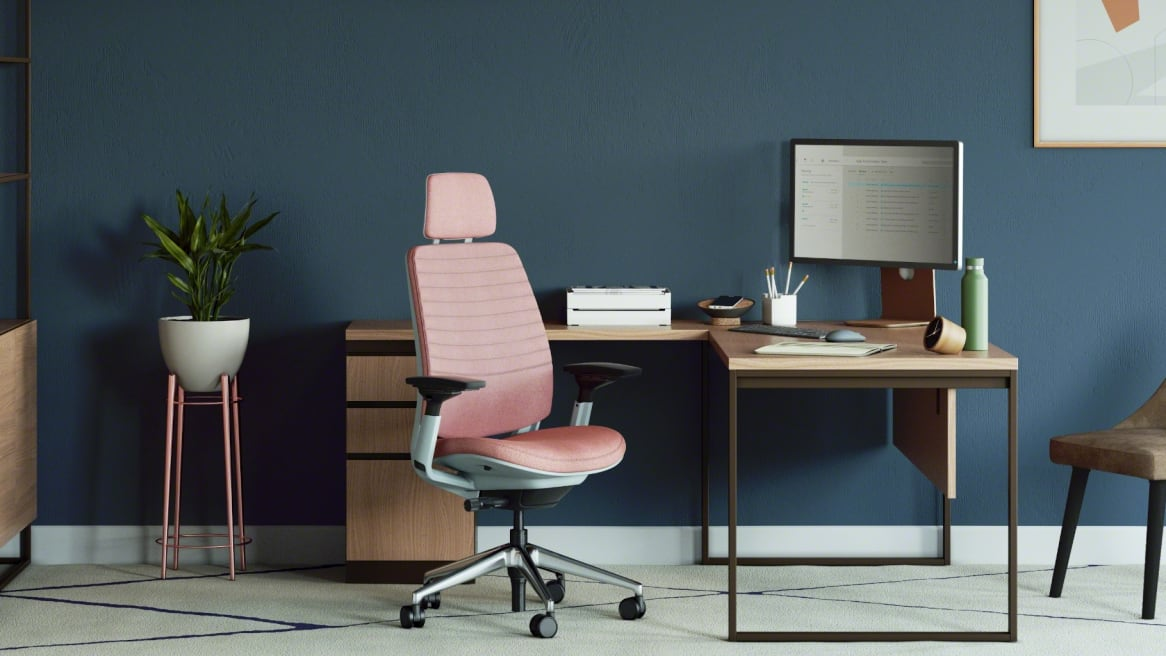 private office with a square wooden desk, metal legs and a pink Series 2 office chair with head rest