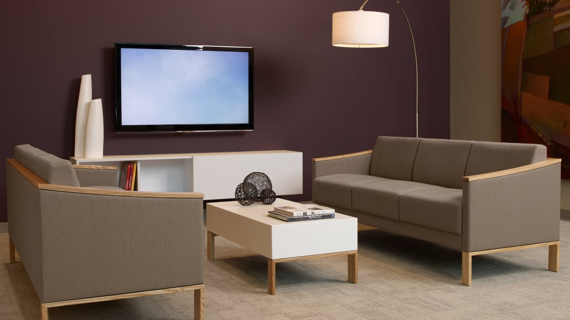 Tan Tava Loveseat, Sofa and Single Chairs around a White Coffee Table in a waiting room