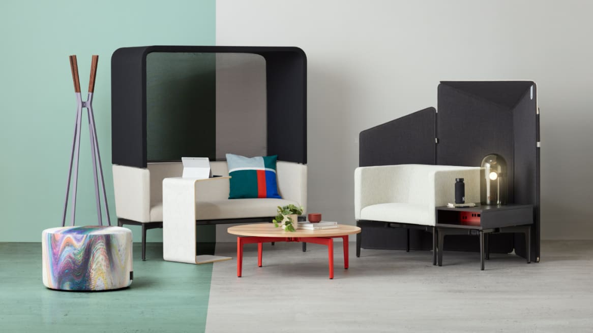 Ancillary space equipped with Turnstone Bivi Rumble Seat and Hoodie with a white Bassline Box Top Table on the side and a veneer Turnstone Bassline Occasional Table in the front..
