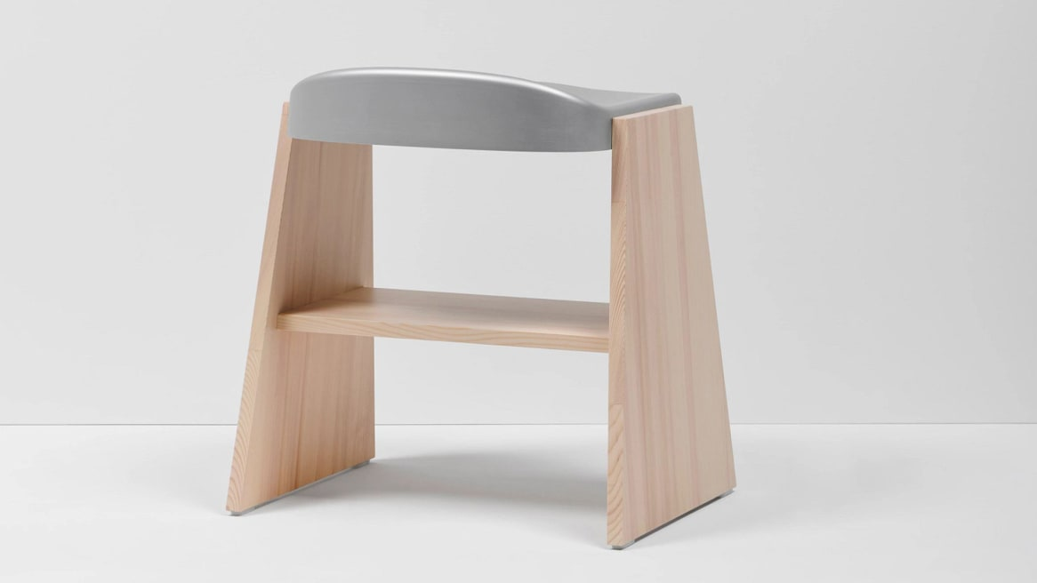 Back view of a Mattiazzi Fronda Low Stool with Natural Pine Base and Grey Steel Seat