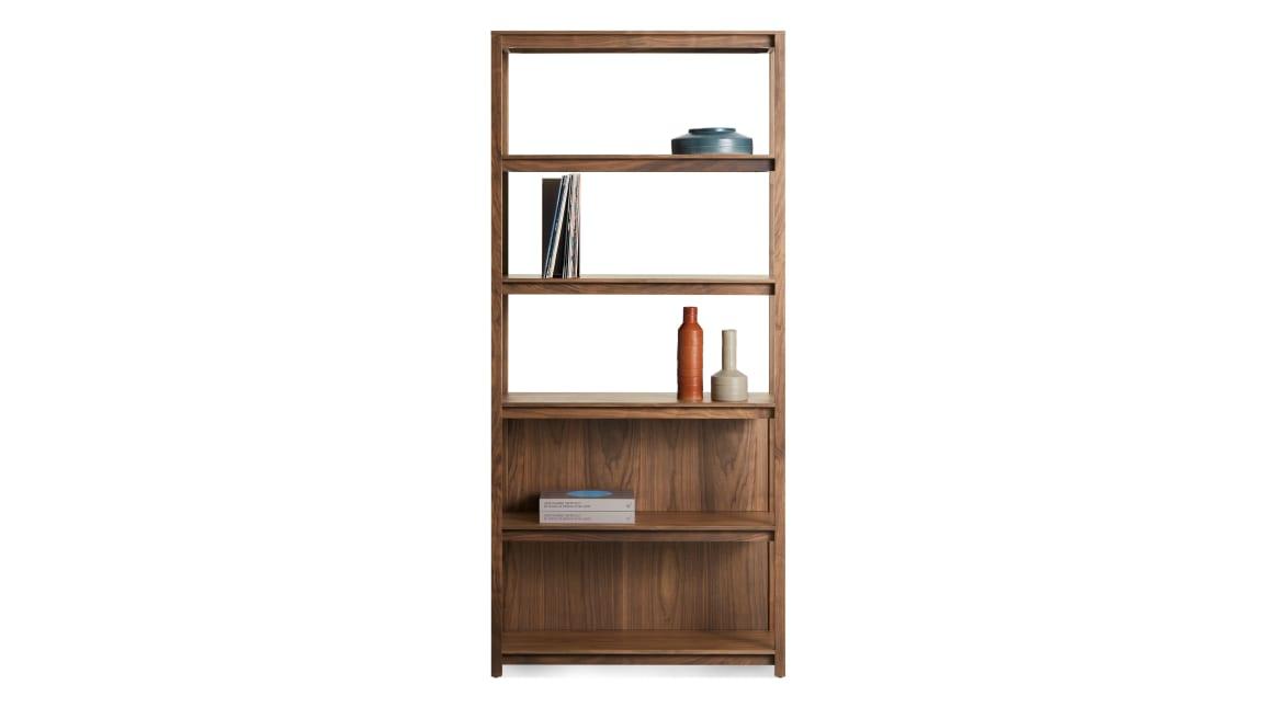 walnut open plan bookcase with stuff on it