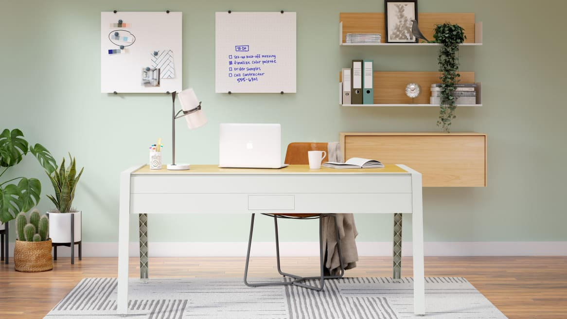 Home office space equipped with PolyVision Nota whiteboards, a large light-gray desk and brown chair.