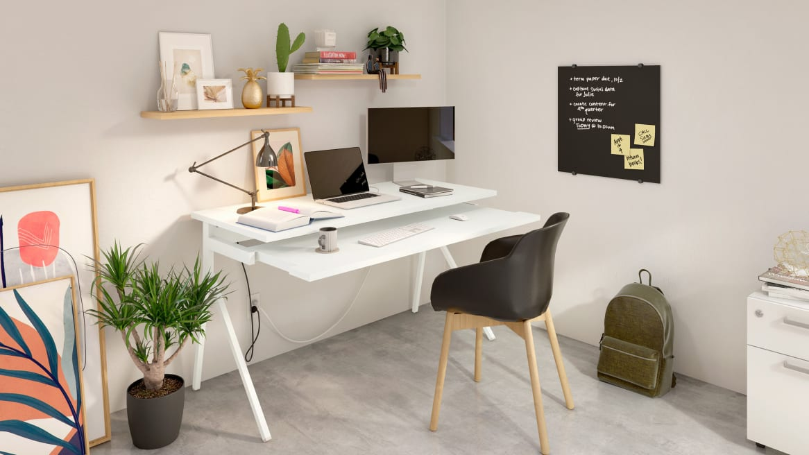 Home office space equipped with PolyVision Nota chalkboard, a white desk and a black chair.