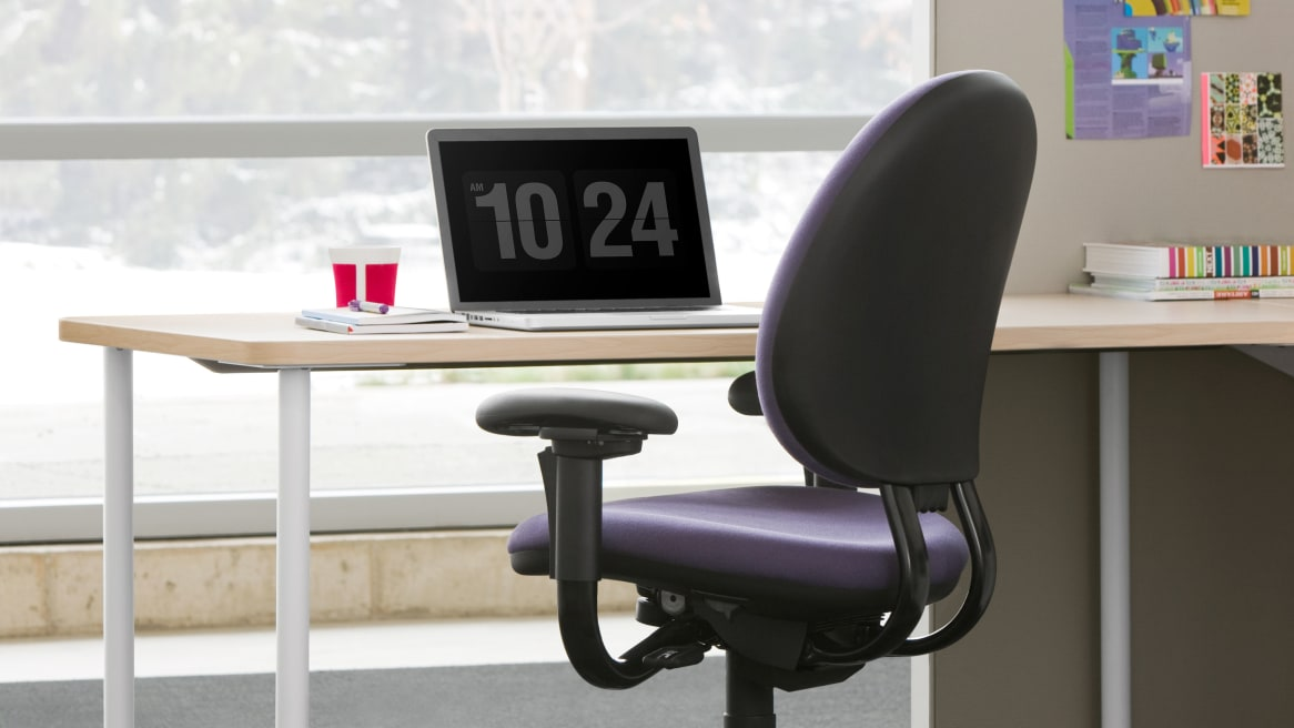 Purple Criterion task chair in front a desk and laptop.