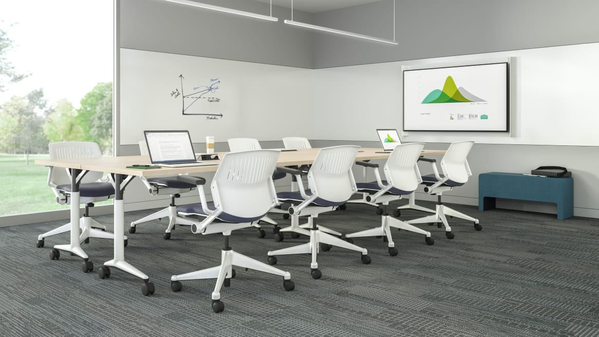 Conference room equipped with an Akira Table, white Kart Chairs and whiteboards.