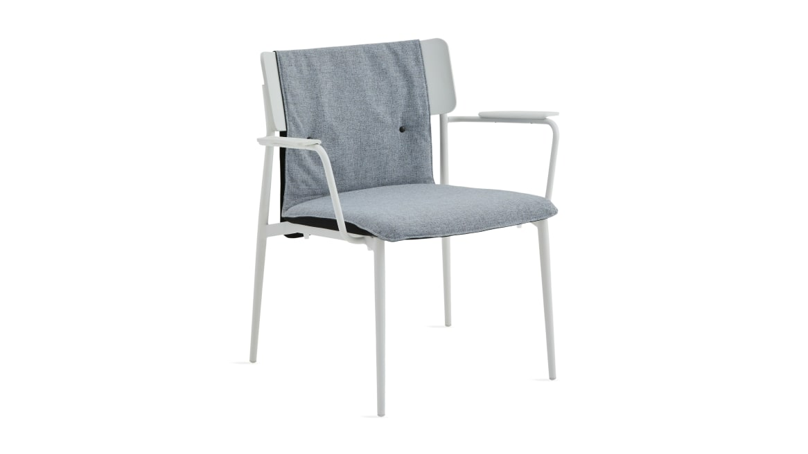 simple lounge with gray cushion and white base