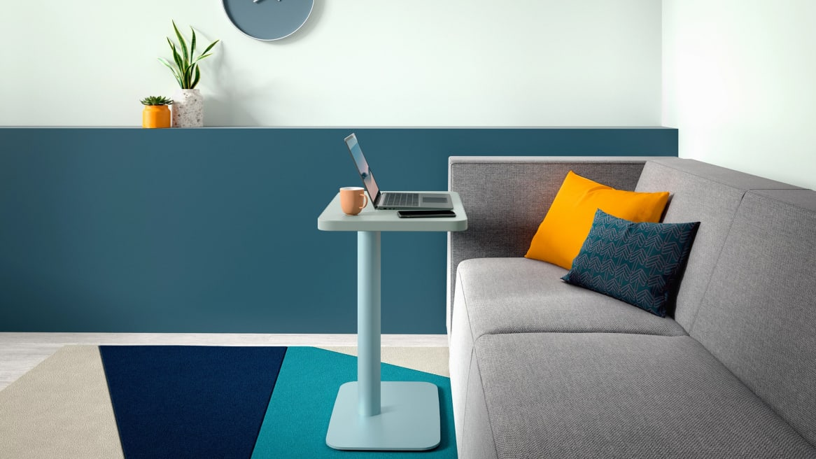 blue simple table with laptop on it