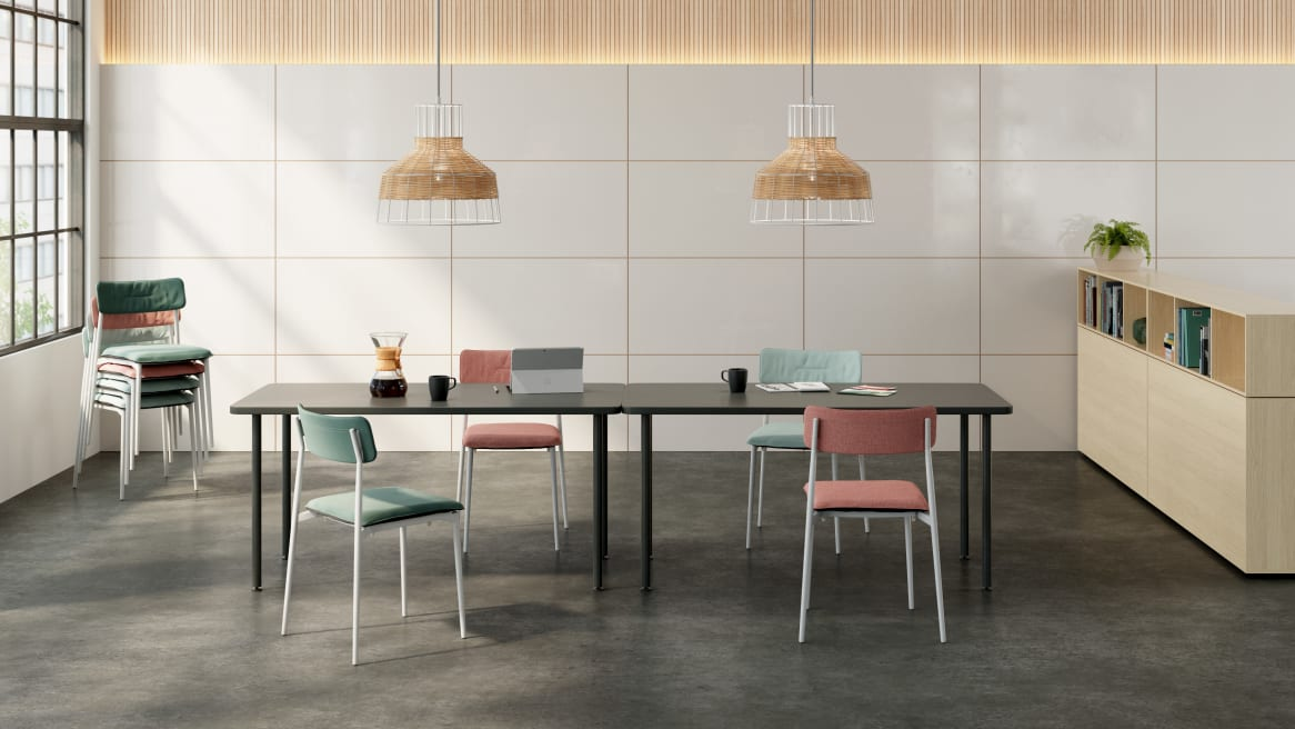 Office space with a black Simple Table and light blue and pink Simple Chairs.