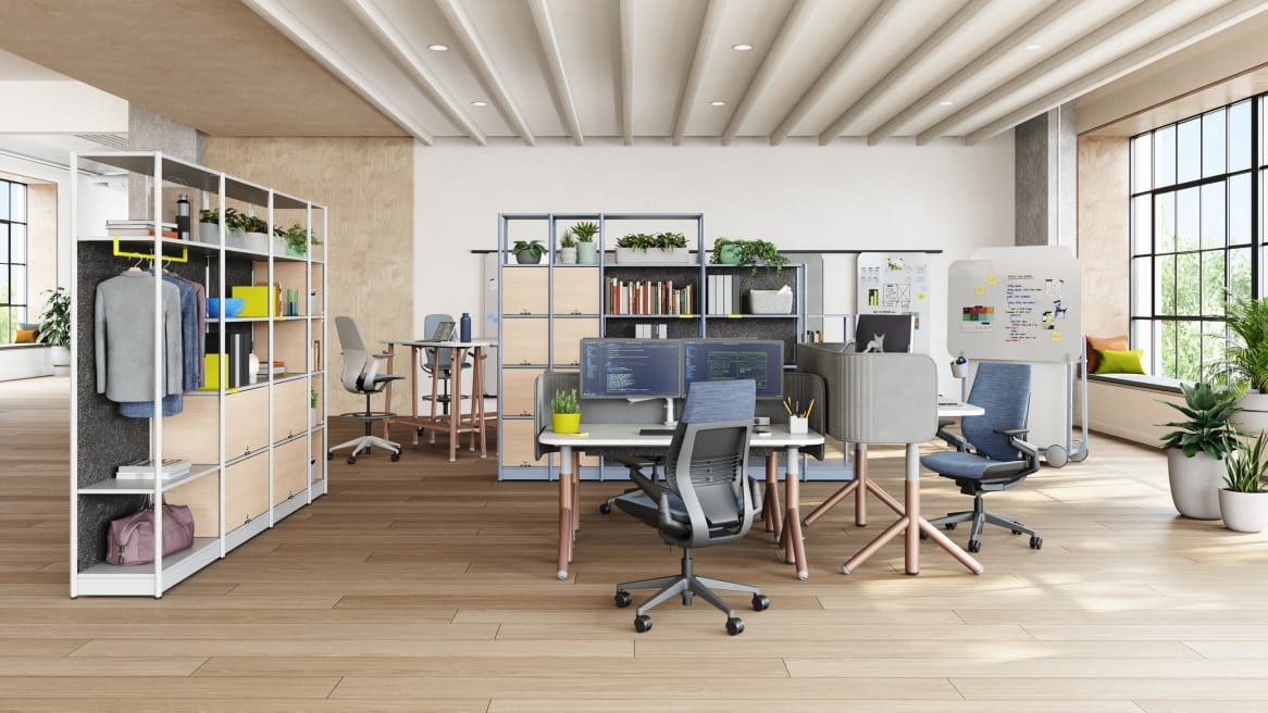 Workspace equipped with Steelcase Flex Height Adjustable Desk, blue Gesture Chairs, Steelcase Flex Slim Table, SILQ Stools and Steelcase Flex Active Frames for space division.