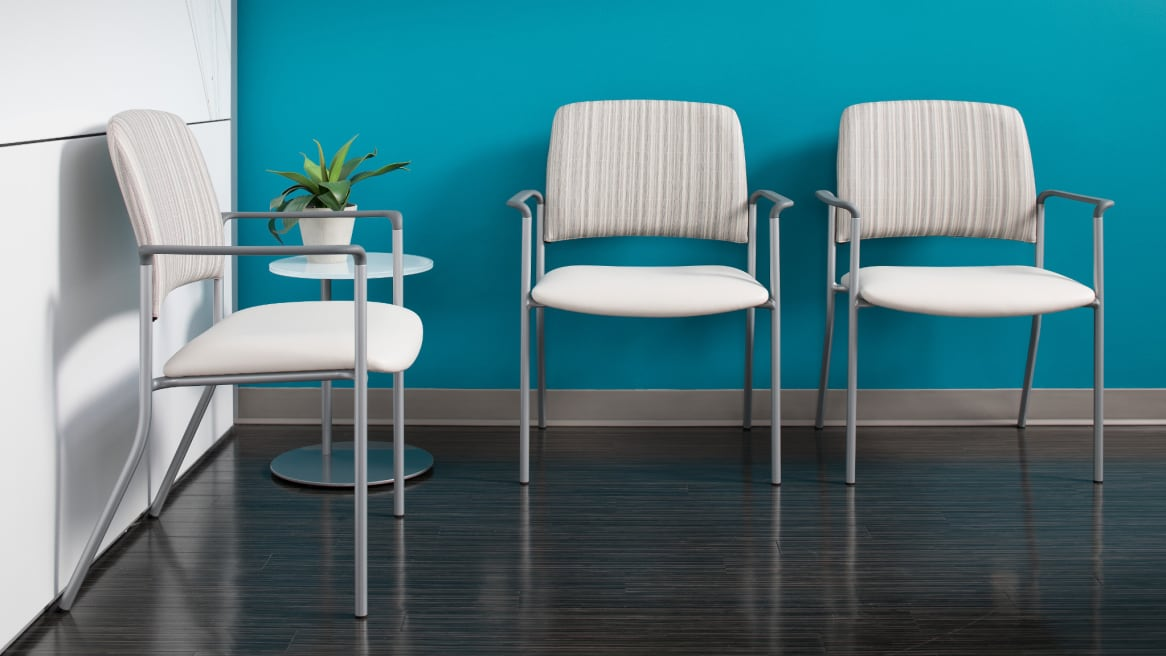 three sorrel chairs with arm rest, small standing table next to them