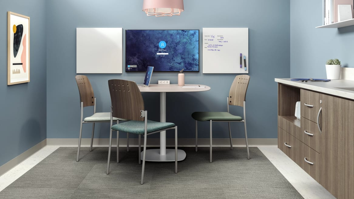 private room with 3 sorrel chairs without arm rest, a table is in the middle, markerboards on the wall
