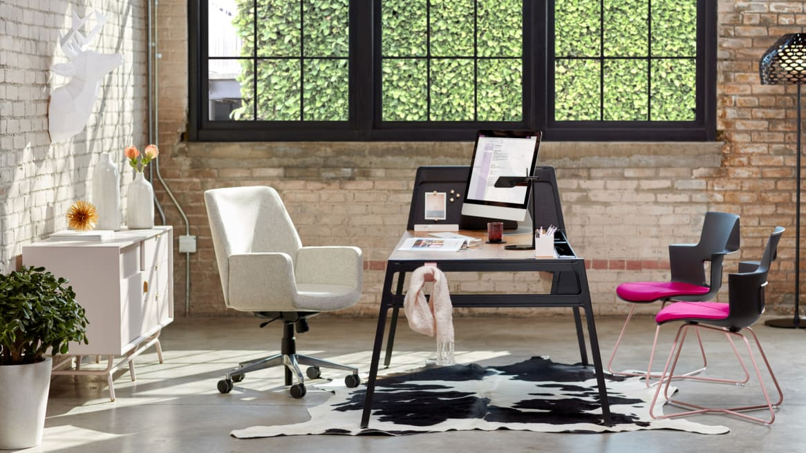 private office with a black bivi table for one and a white lounge chair