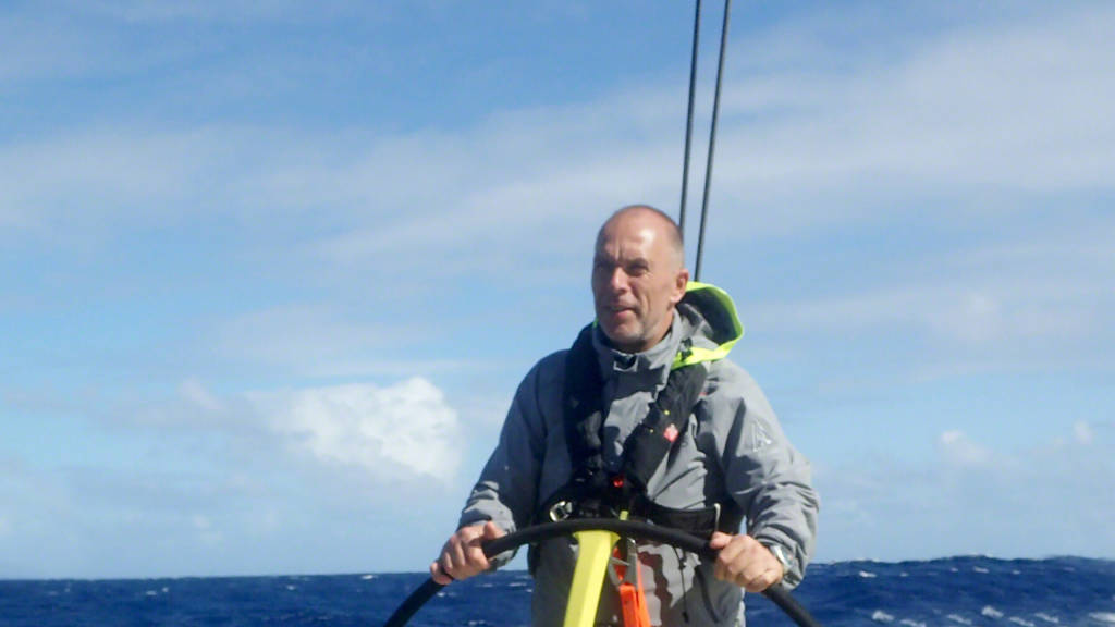 Rick Bomer at the helm of the Brunel sailboat during the Atlantic Rally for Cruisers.
