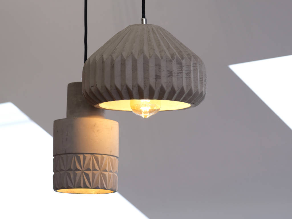 Two lamps hanging from ceiling