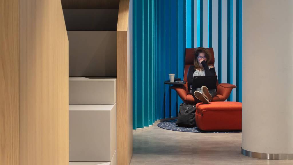 Woman seating on Coalesse Massaud Lounge