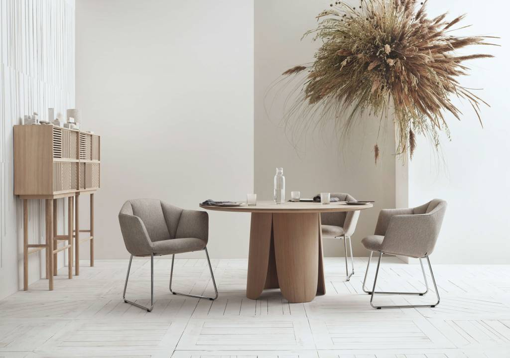 Three gray Bolia Kimono dining chairs around a dining table