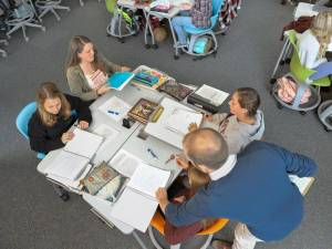 An overhead view of students working together while using Verb Active tables and Node tripod base chairs