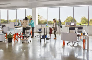 Steelcase Flex Collection products are used in an office setting. Steelcase Gesture chairs are also seen.