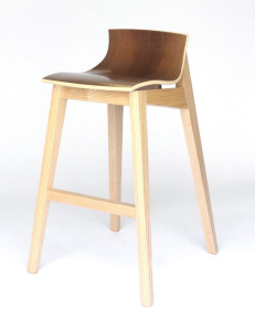 A wood stool with bentwood seat by Hunt & Noyer on white