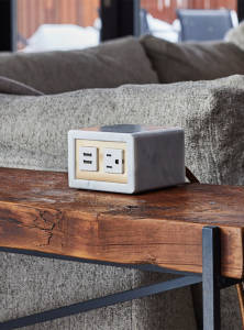 power source on top of a wooden side table