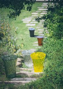 garden with kartell vases