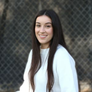 photo of Next student participant smiling and wearing a white sweater