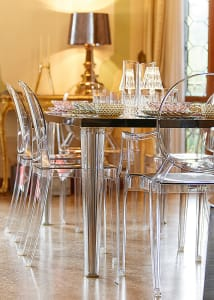 dining room with transparent kartell chairs